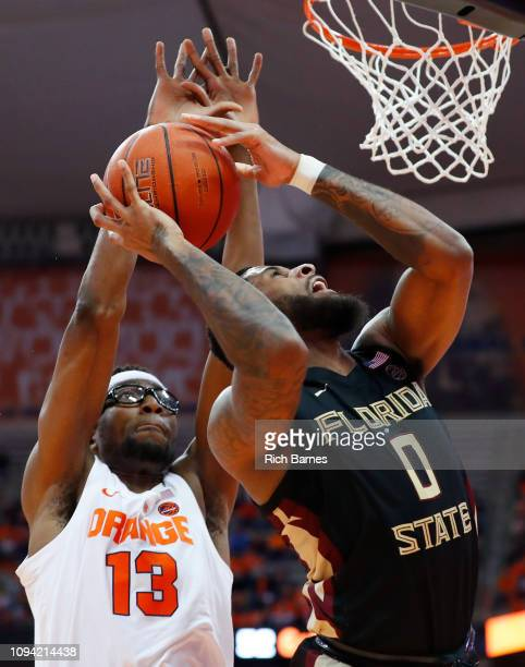 Phil Cofer of the Florida State Seminoles shoots the ball in front of Paschal Chukwu of the Syracuse Orange during the second half at the Carrier...