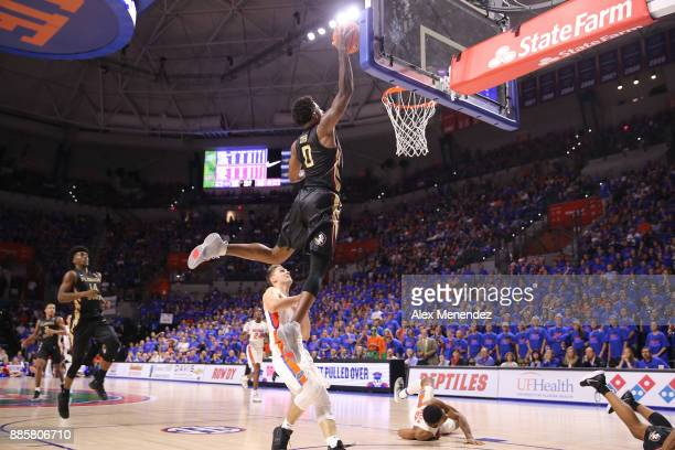 Phil Cofer of the Florida State Seminoles slam dunks the ball over Egor Koulechov of the Florida Gators during a NCAA basketball game at the Stephen...