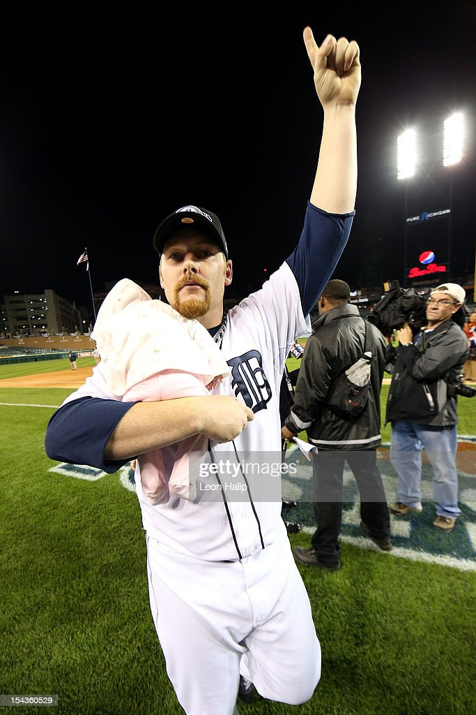 Phil Coke #40 of the Detroit Tigers holds his baby daughter Mickenzie Lou Ann as he celebrates on the field following the Tigers 8-1 win against the New York Yankees during game four of the American League Championship Series at Comerica Park on October 18, 2012 in Detroit, Michigan.