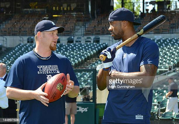 Phil Coke of the Detroit Tigers talks with Detroit Lions wide receiver Calvin Johnson during batting practice before the game between the Detroit...