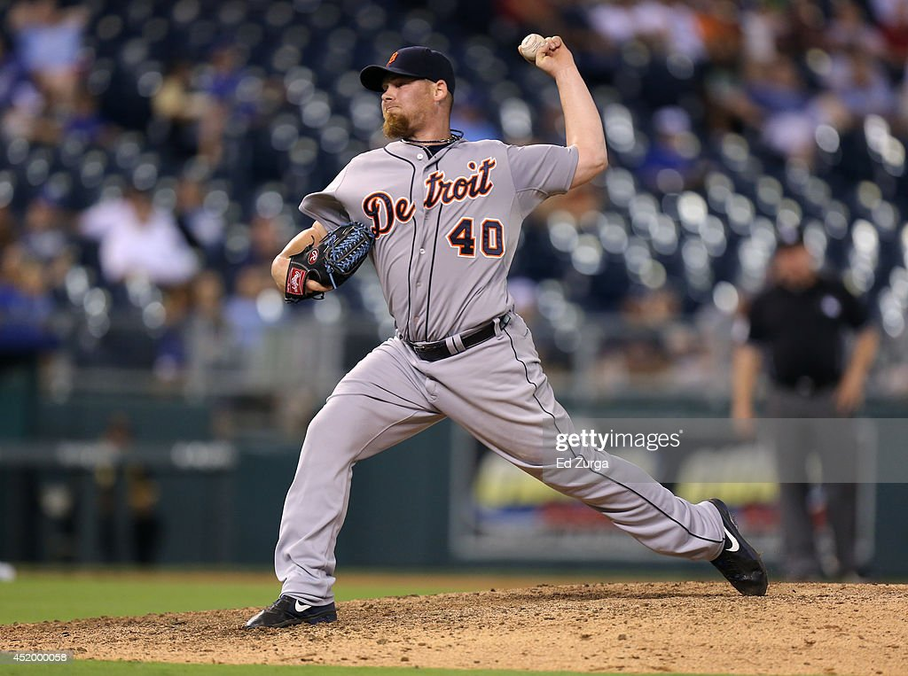 Phil Coke #40 of the Detroit Tigers throws in the ninth inning against the Kansas City Royals at Kauffman Stadium on July 10, 2014 at Kauffman Stadium in Kansas City, Missouri. The Tigers won 16-4.