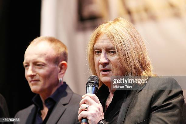 Phil Collen and Joe Elliott of Def Leppard speak onstage during the KISS and Def Leppard announcment of their 2014 Summer tour held at The House of...