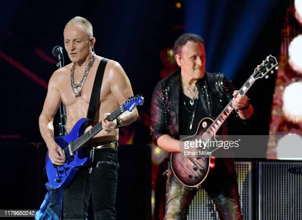 Phil Collen and Vivian Campbell of Def Leppard perform onstage during the 2019 iHeartRadio Music Festival at TMobile Arena on September 21 2019 in...