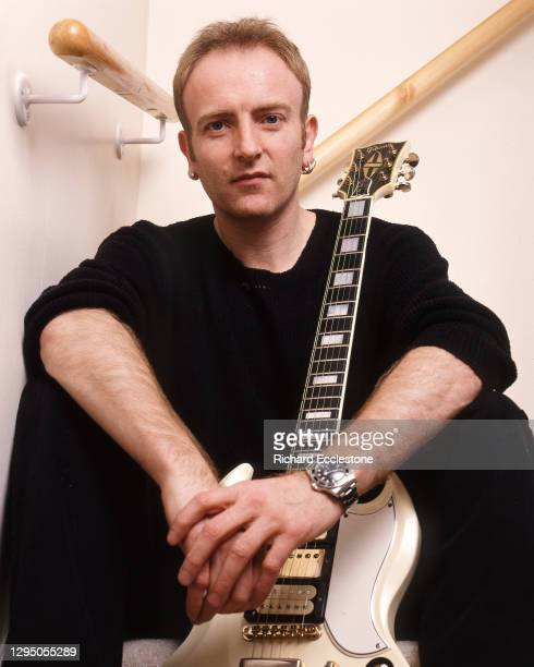 Phil Collen, English lead guitarist and member of rock band Def Leppard, 1996. He is holding a Gibson SG Custom guitar.