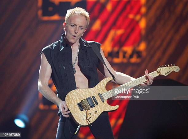 """Phil Collen of Def Leppard perform """"Pour Some Sugar on Me"""""""