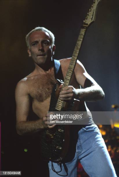 Phil Collen of Def Leppard performs at Shoreline Amphitheatre on August 31, 1996 in Mountain View, California.