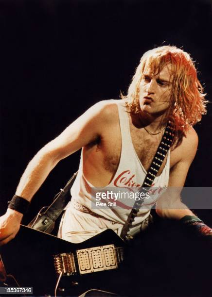 Phil Collen of Def Leppard performs on stage at Hammersmith Odeon on December 5th 1983 in London England