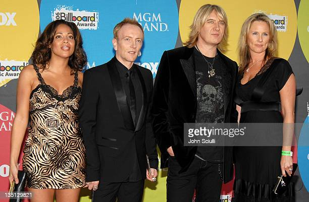 Phil Collen of Def Leppard with wife Anita and Joe Elliott of Def Leppard with wife Kristine