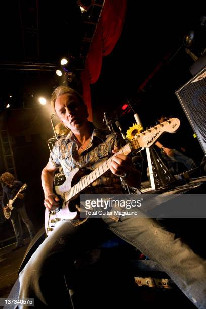 Phil Collen of English hard rock group Def Leppard posing with his Jackson PC1 signature guitar during a soundcheck at the O2 Academy in London, on...