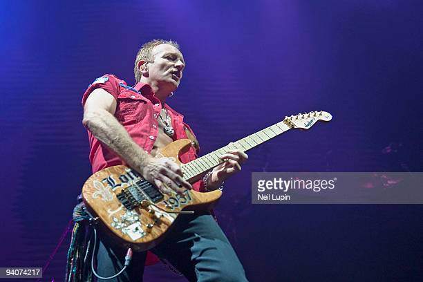 Phil Collen of Man Raze performs on stage at the Brighton Centre on December 5 2009 in Brighton England