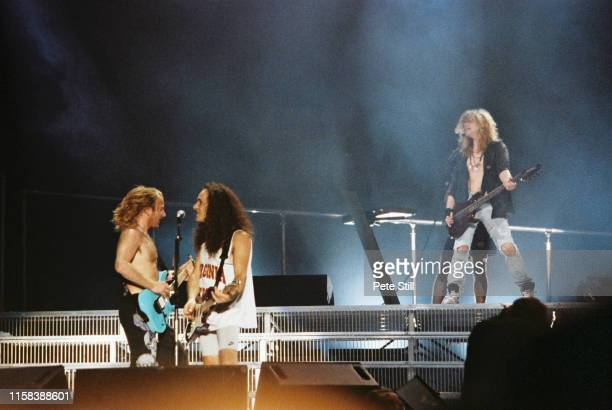 Phil Collen Vivian Campbell and Rick Savage of Def Leppard perform on stage at The Don Valley Stadium on June 6th 1993 in Sheffield England