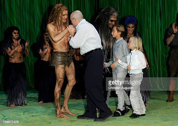 Phil Collins and both sons Matthew Collins and Nicholas Collins meet Alexander Klaws during Tarzan Musical 3rd anniversary at Theatre Neue Flora on...