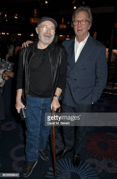 Phil Collins and Eric Clapton at the Nordoff Robbins O2 Silver Clef Awards at The Grosvenor House Hotel on June 30 2017 in London England