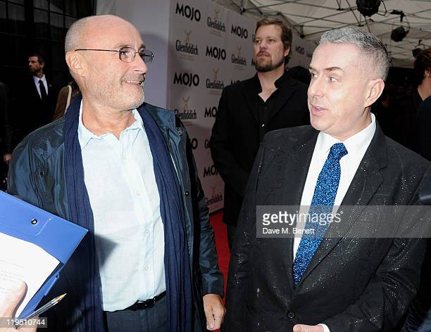 Phil Collins and Holly Johnson arrive at the Glenfiddich Mojo Honours List 2011 awards ceremony at The Brewery on July 21 2011 in London England