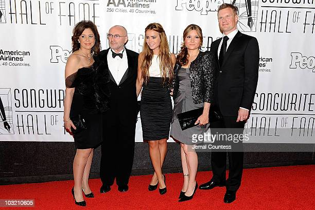 Phil Collins and Lily Collins pose with guests at the 41st Annual Songwriters Hall of Fame Ceremony at The New York Marriott Marquis on June 17 2010...