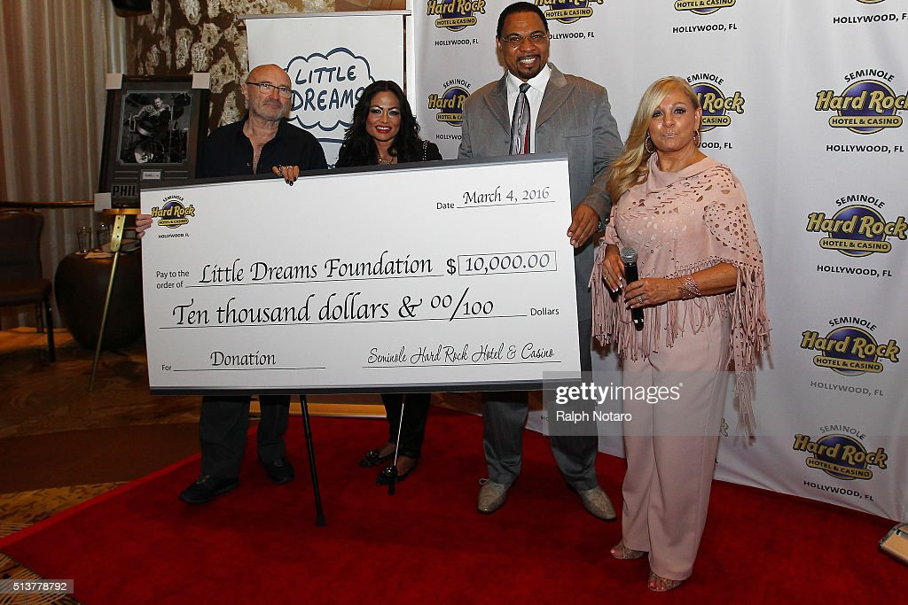 Phil Collins and Orianne Cevey accepts a $10,000 donation from the Seminole Hard Rock during the Little Dreams Foundation Press Conference at LBar in Seminole Hard Rock Hotel & Casino Hollywood on March 4, 2016 in Hollywood, Florida.