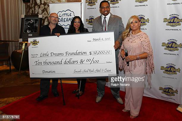 Phil Collins and Orianne Cevey accepts a $10000 donation from the Seminole Hard Rock during the Little Dreams Foundation Press Conference at LBar in...