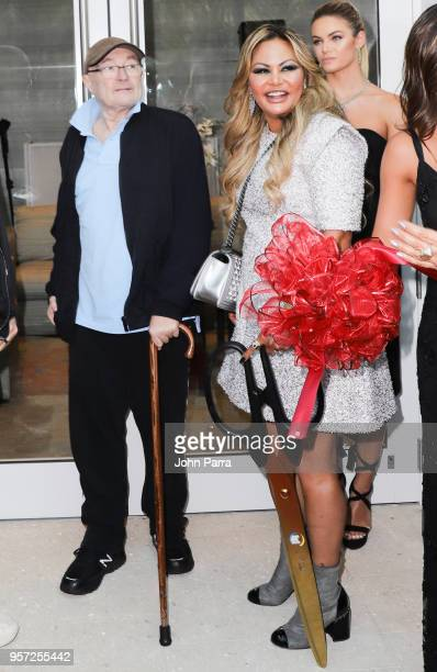 Phil Collins and Orianne Collins attend Orianne Collins Jewellery Grand Opening on May 10 2018 in Miami Florida