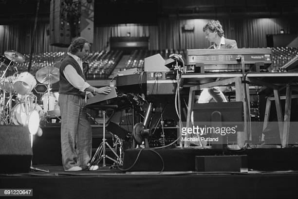 Phil Collins and Tony Banks of English rock group Genesis at a soundcheck at the Rosemont Horizon Rosemont Illinois during the band's Invisible Touch...