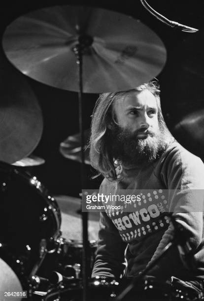Phil Collins drummer and singer with British rock band Genesis takes a break behind his drum kit while rehearsing at the Rainbow Theatre London UK...
