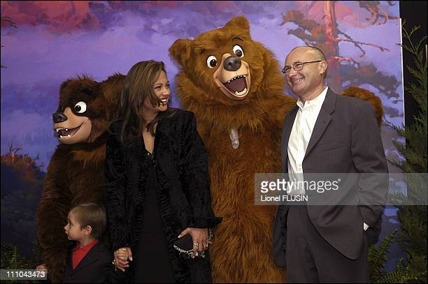 Phil Collins his wife Orianne and his son Nicholas at the premiere of Frere des Ours at the Geneva Arena Switzerland on March 20 2004