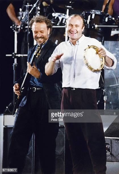Phil Collins of Genesis is accompanied by Daryl Stuermer on stage at Knebworth '90 on June 30th 1990 in Knebworth England