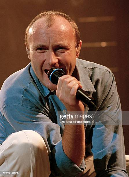 Phil Collins performing on stage at the Wembley Arena in London, circa December 1994.