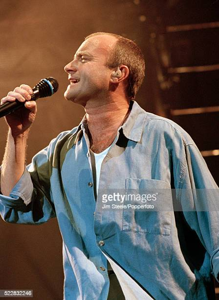 Phil Collins performing on stage at the Wembley Arena in London circa December 1994