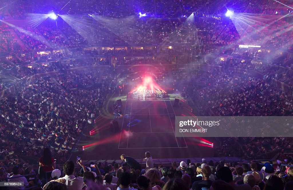 TOPSHOT - Phil Collins performs during the opening ceremony at the 2016 US Open on August 29, 2016 in New York. / AFP / Don EMMERT
