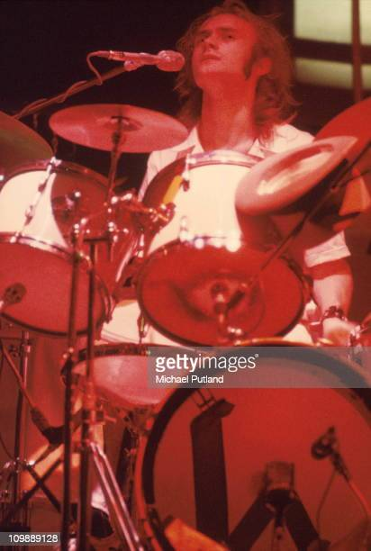 Phil Collins performs on stage with Genesis playing drums circa 1972