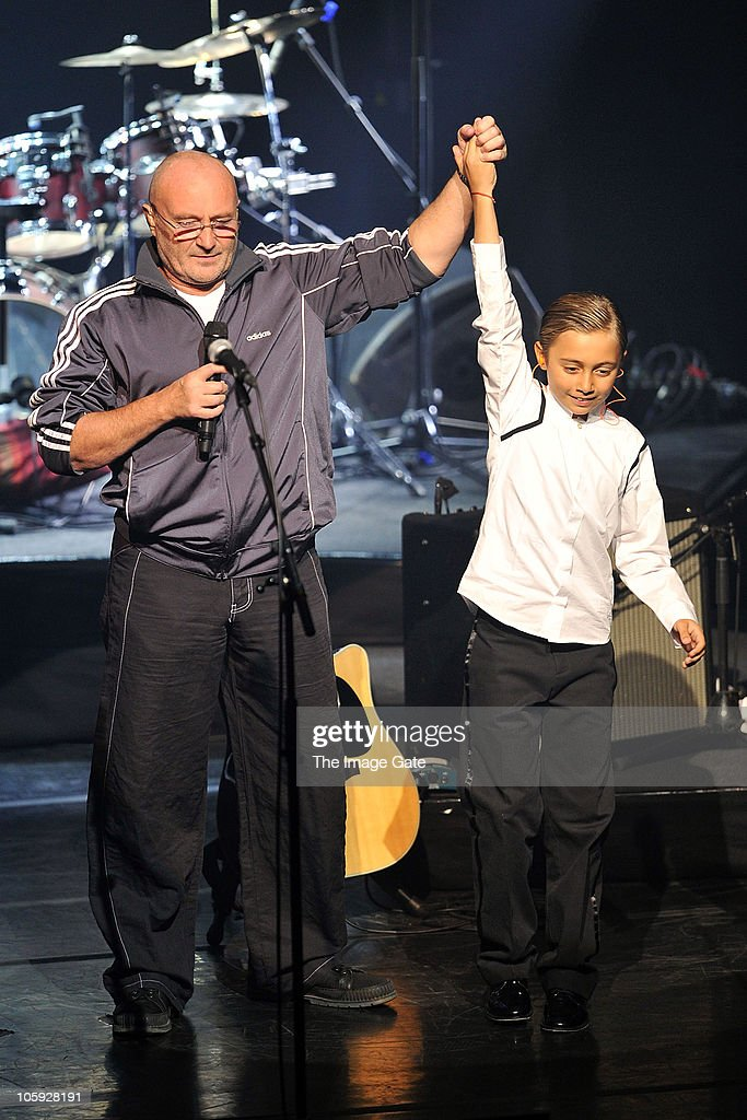 Phil Collins thanks his son Nicholas Collins, who played the drums, as his father was unable to perform due to his hand condition, during the Little Dreams Foundation 10th Anniversary Gala at Leman Theatre on October 21, 2010 in Geneva, Switzerland.