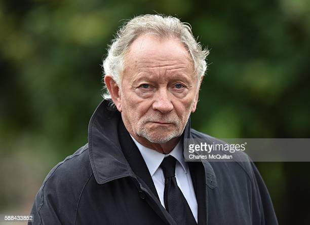 Phil Coulter arrives for the funeral of the late retired Bishop of Derry Dr Edward Daly as he lies in state at St Eugene's Cathedral on August 11...
