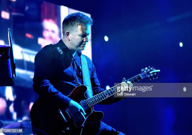 Phil Cunningham of New Order performs on stage at Alexandra Palace on November 9 2018 in London England