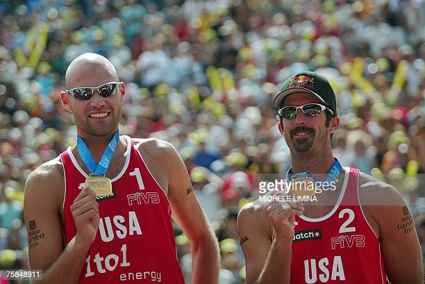 Phil Dalhausser and his teammate Todd Rogers show their gold medal after their victory over Russia's Dmitri Barsouk and Igor Kolodinsky during the...