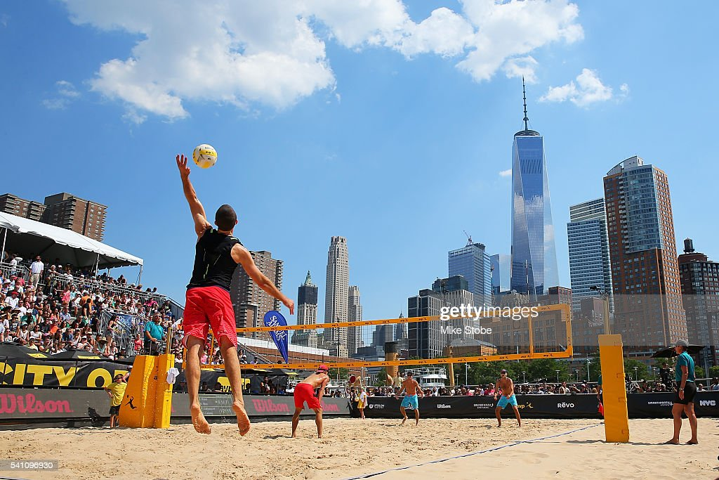 Phil Dalhausser and Nick Lucena play against Dave McKienzie and Curt Toppel during the Men's AVP New York Open at Hudson River Park on June 18, 2016 in New York City.