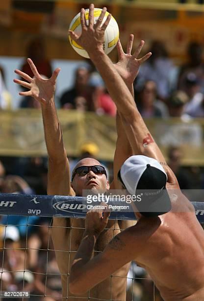 Phil Dalhausser blocks a hit from Jake Gibb in the AVP Santa Barbara Open semi final match on September 7, 2008 in Santa Barbara, California. Phil...
