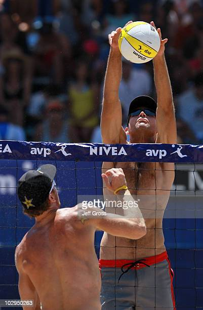 Phil Dalhausser blocks a shot from Casey Jennings during the AVP Hermosa Beach Open at the Hermosa Beach Pier on July 17 2010 in Hermosa Beach...