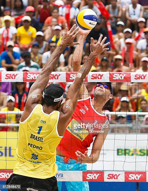Phil Dalhausser of the United States spikes the balll during the golden medal match agains Brazil at Pajucara beach during day six of the FIVB Beach...