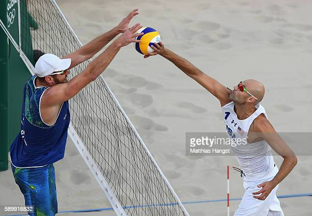 Phil Dalhausser of United States plays a shot against Bruno Schmidt Oscar of Brazil during the Men's Beach Volleyball Quarterfinal match between the...