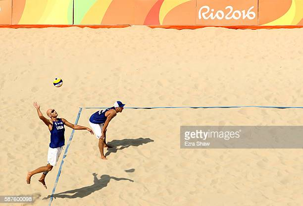 Phil Dalhausser of United States spikes the ball during the Men's Beach Volleyball Preliminary Pool C match against Rodolfo Lombardo Ontiveros Gomez...