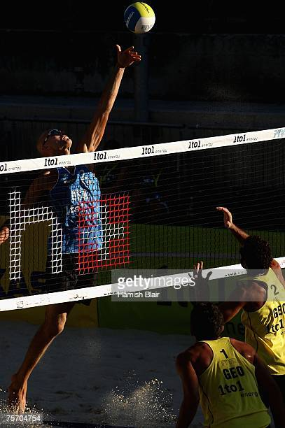Phil Dalhausser of USA attempts to block a shot with Renato Gomes and Jorge Terceiro of Georgia looking on during day three of the FIVB 2007 Beach...