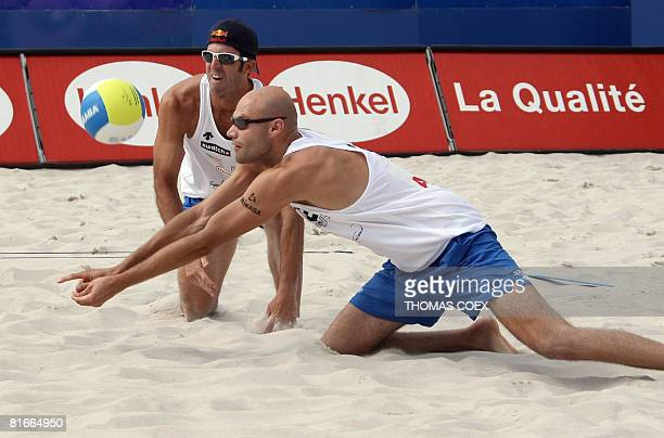 US Phil Dalhausser returns the ball to Netherlands Reinder Nummerdor and Richard Schuil eyed by his teammate and compatriot Todd Rogers during their...