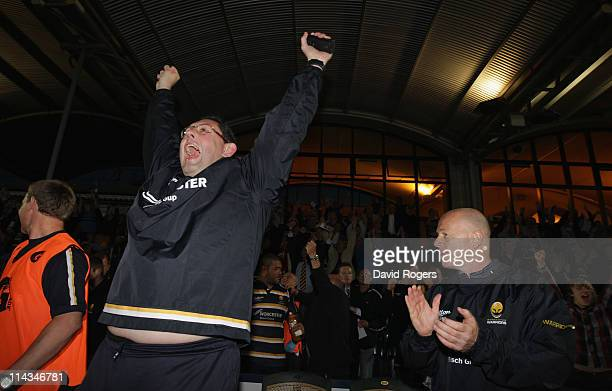 Phil Davies the Worcester assistant coach and head coach Richard Hill celebrate Worcester's promotion after their victory during the RFU Championship...