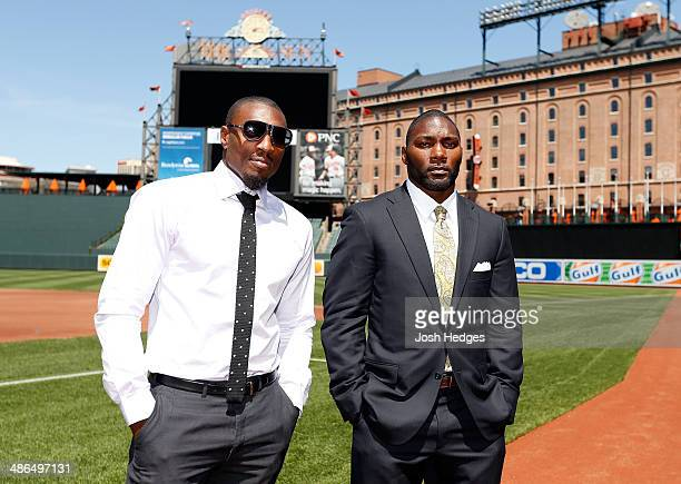 Phil Davis and Anthony Johnson pose for photos on the field at Camden Yards on April 24 2014 in Baltimore Maryland