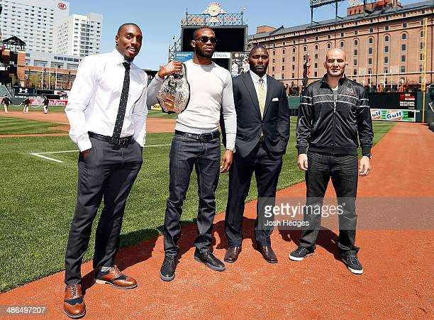 Phil Davis Jon Jones Anthony Johnson and Glover Teixeira pose for photos on the field at Camden Yards on April 24 2014 in Baltimore Maryland