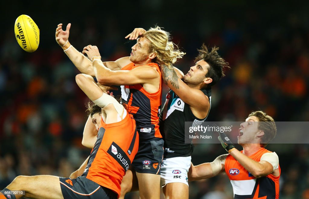 Phil Davis, Nic Haynes and Toby Greene of the Giants contest a mark against Chad Wingard of the Power during the round four AFL match between the Greater Western Sydney Giants and the Port Adelaide Power at UNSW Canberra Oval on April 15, 2017 in Canberra, Australia.