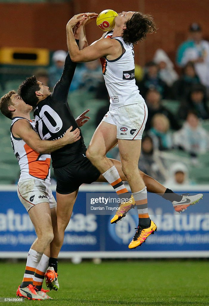 Phil Davis of the Giants attempts to mark the ball during the round 18 AFL match between the Port Adelaide Power and the Greater Western Sydney Giants at Adelaide Oval on July 24, 2016 in Adelaide, Australia.