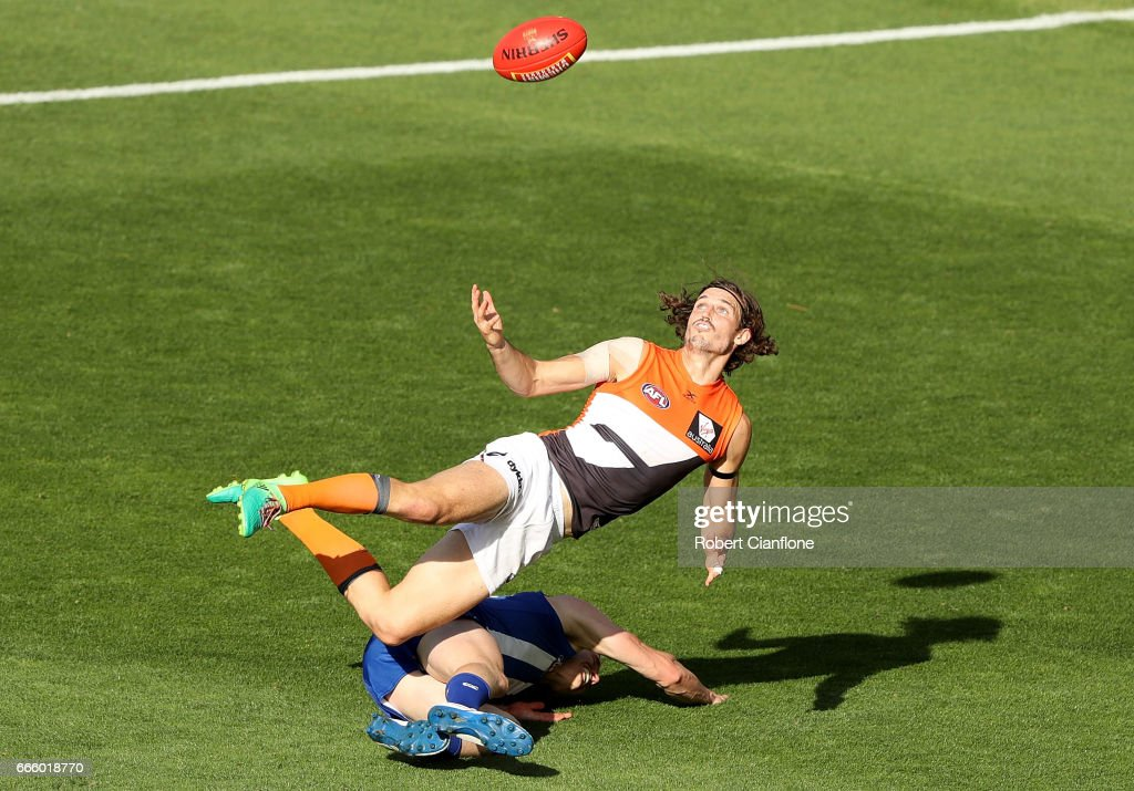 Phil Davis of the Giants collides with Ben Brown of the Kangaroos as he attempts to mark during the round three AFL match between the North Melbourne Kangaroos and the Greater Western Sydney Giants at Blundstone Arena on April 8, 2017 in Hobart, Australia.
