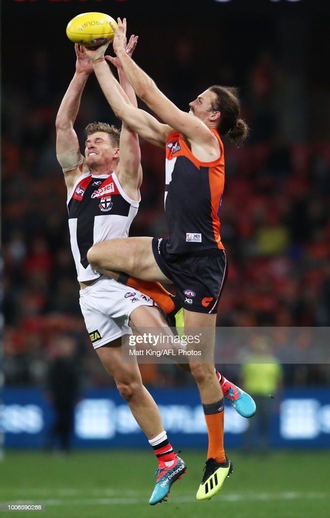 Phil Davis of the Giants competes for the ball against Jack Newnes of the Saints during the round 19 AFL match between the Greater Western Sydney Giants and the St Kilda Saints at Spotless Stadium on July 28, 2018 in Sydney, Australia.