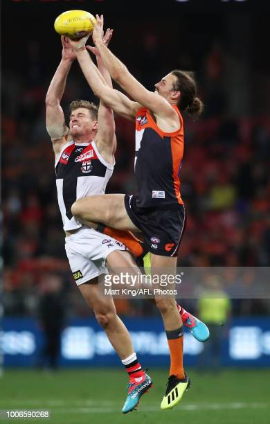 Phil Davis of the Giants competes for the ball against Jack Newnes of the Saints during the round 19 AFL match between the Greater Western Sydney...